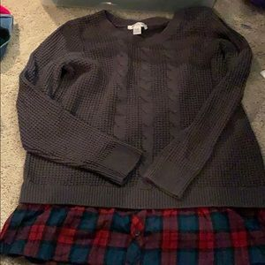 Sweater with plaid fabric along the bottom